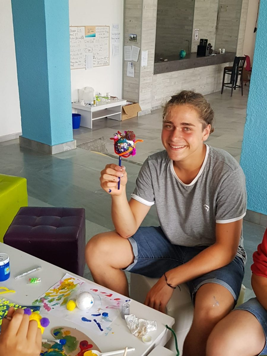 Z camp, day 9 - arts and crafts - a boy holds a hand-made planet