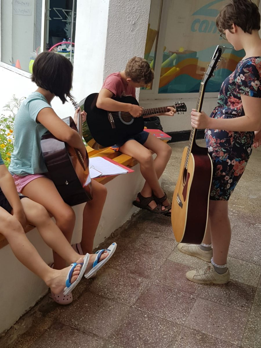 Z camp, day 9 - arts and crafts, children learn to play guitars