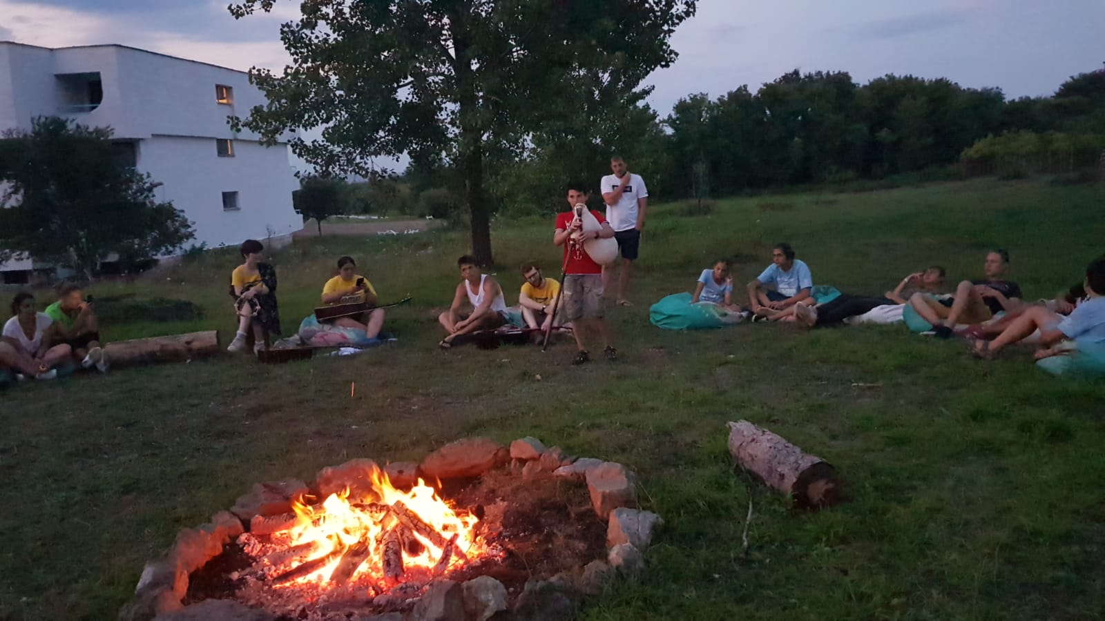 Z camp, day 4 - camp fire and boy with bagpipe