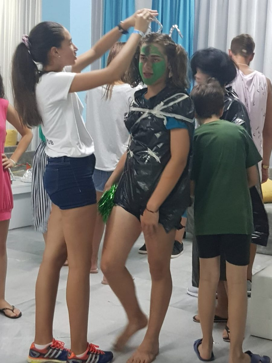 Z camp, Day 11 - Fashion Space Show, Girl with Nylon Dress, Green Face Mask and Head Aunts
