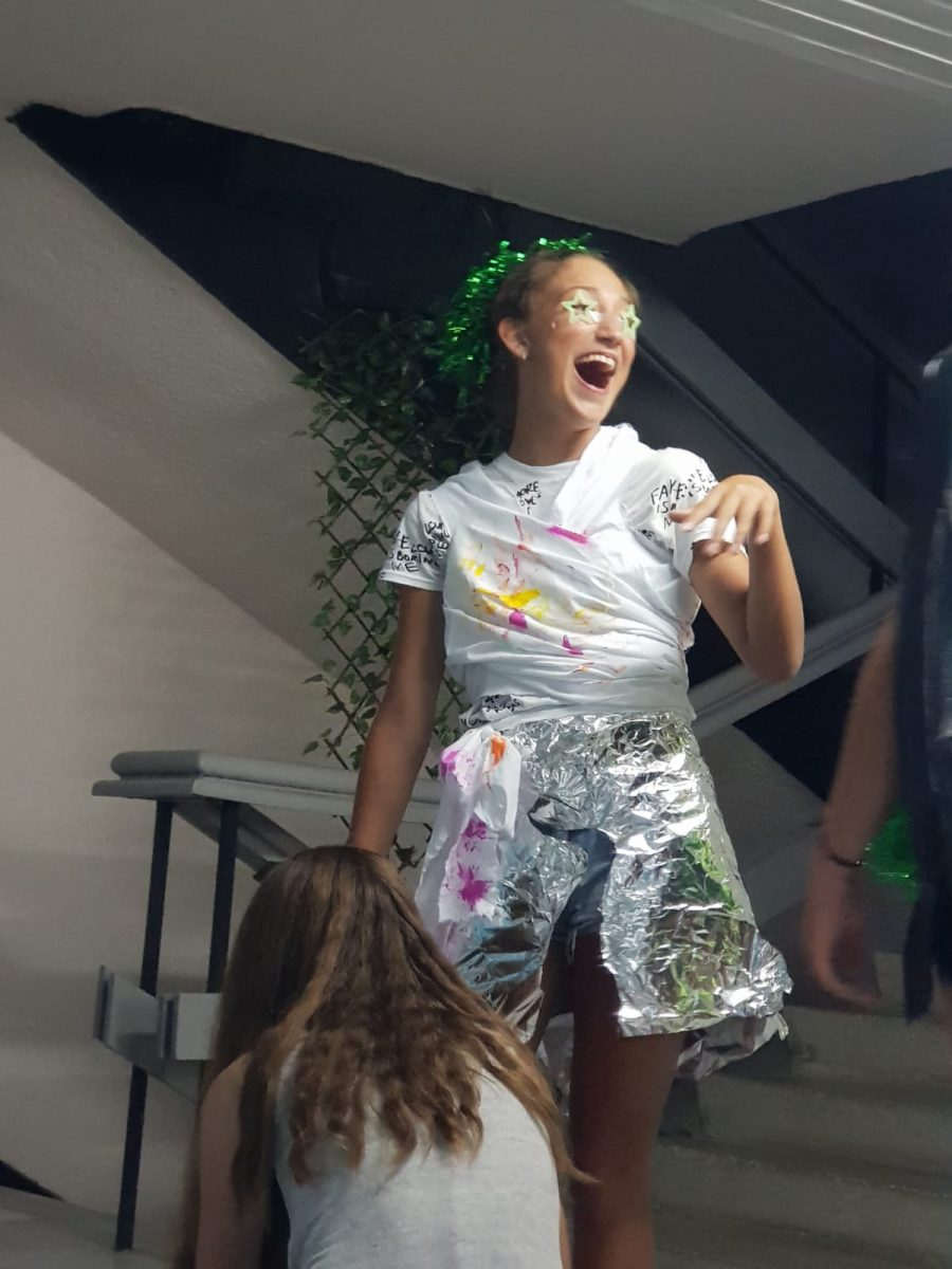 Z camp, Day 11 - Fashion Show Space, girl with a metal foil skirt, white-eyed and green crown on the head