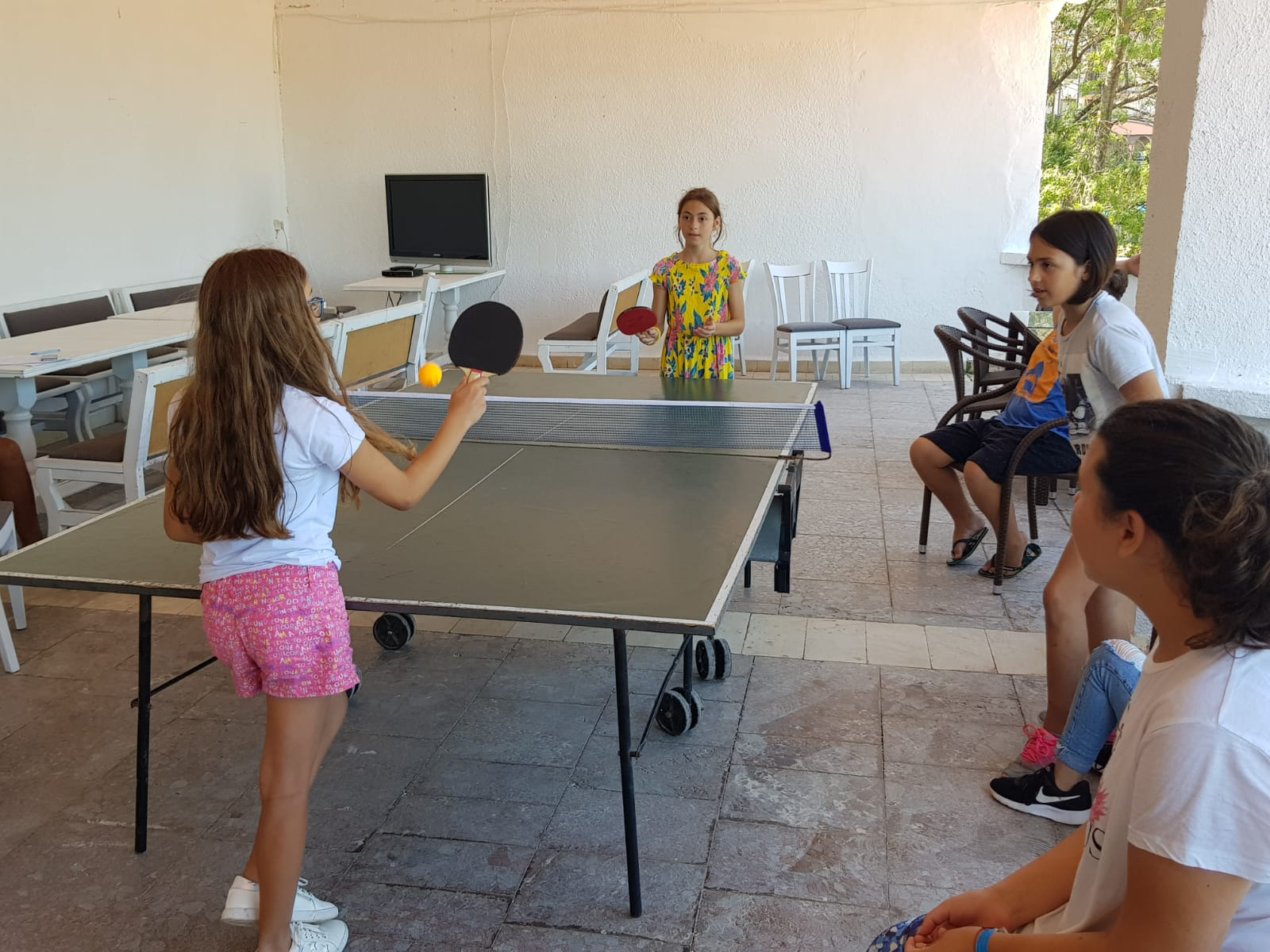 Z camp, day 7 - girls playing table tennis
