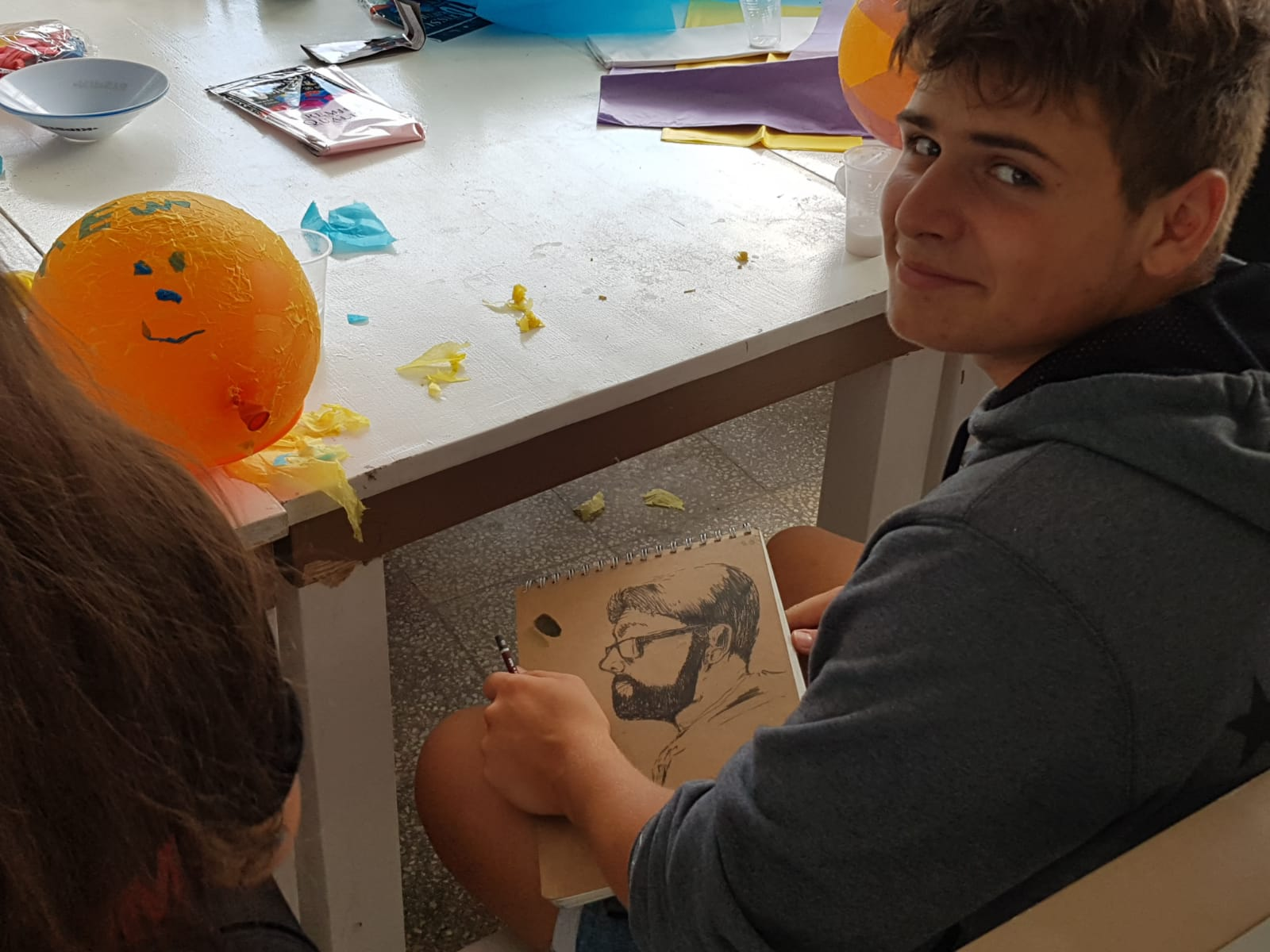 Z camp, day 8 - Arts & Crafts, boy draws a portrait of a man