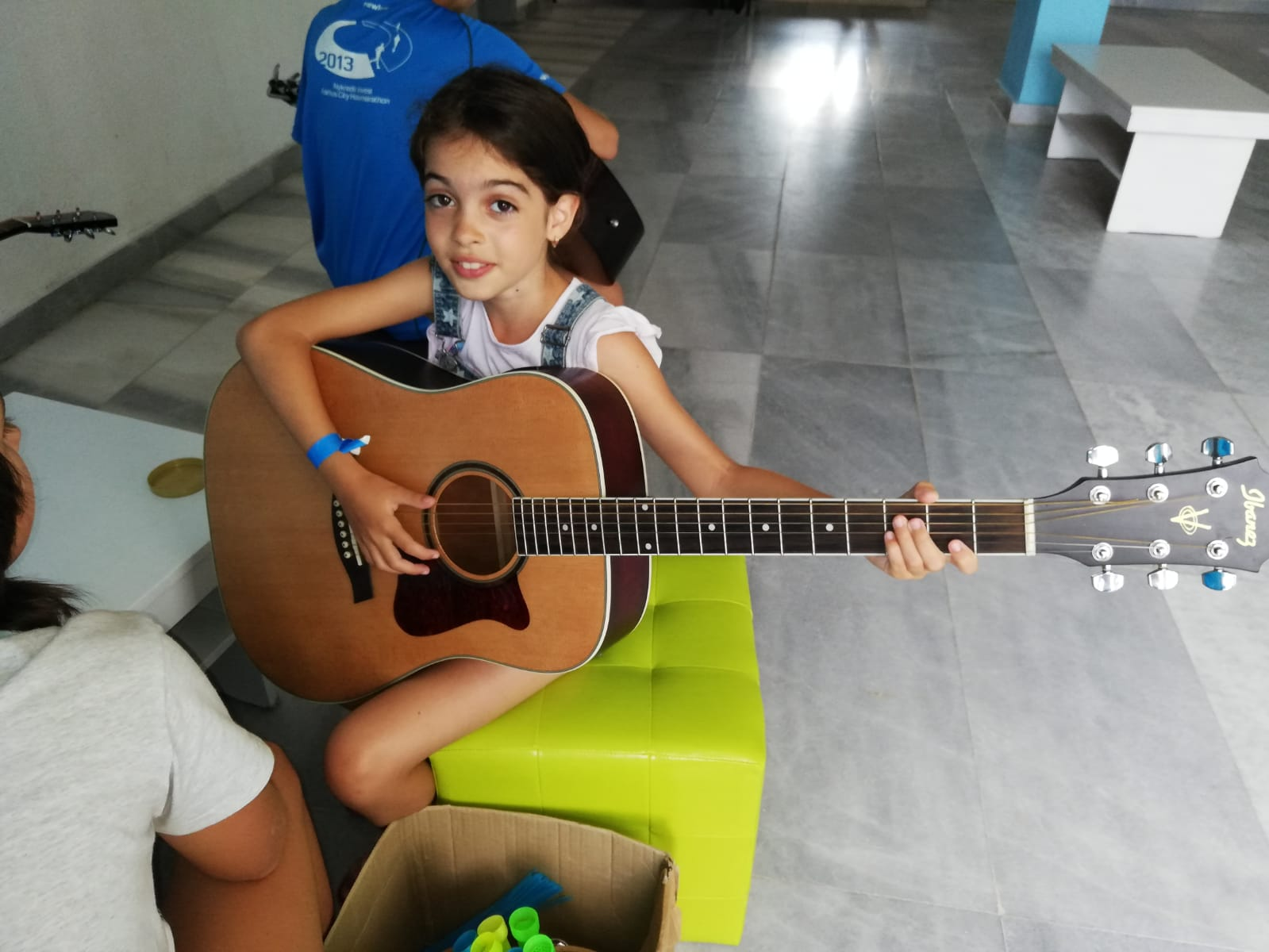 Z camp, day 8 - Music workshop, girl with guitar