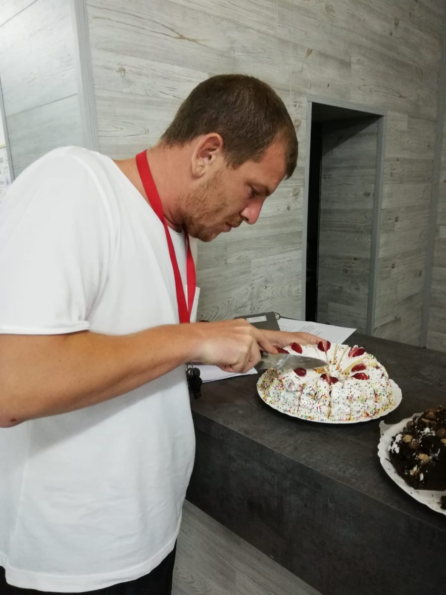 Z camp, day 8 - an English teacher cuts a cake