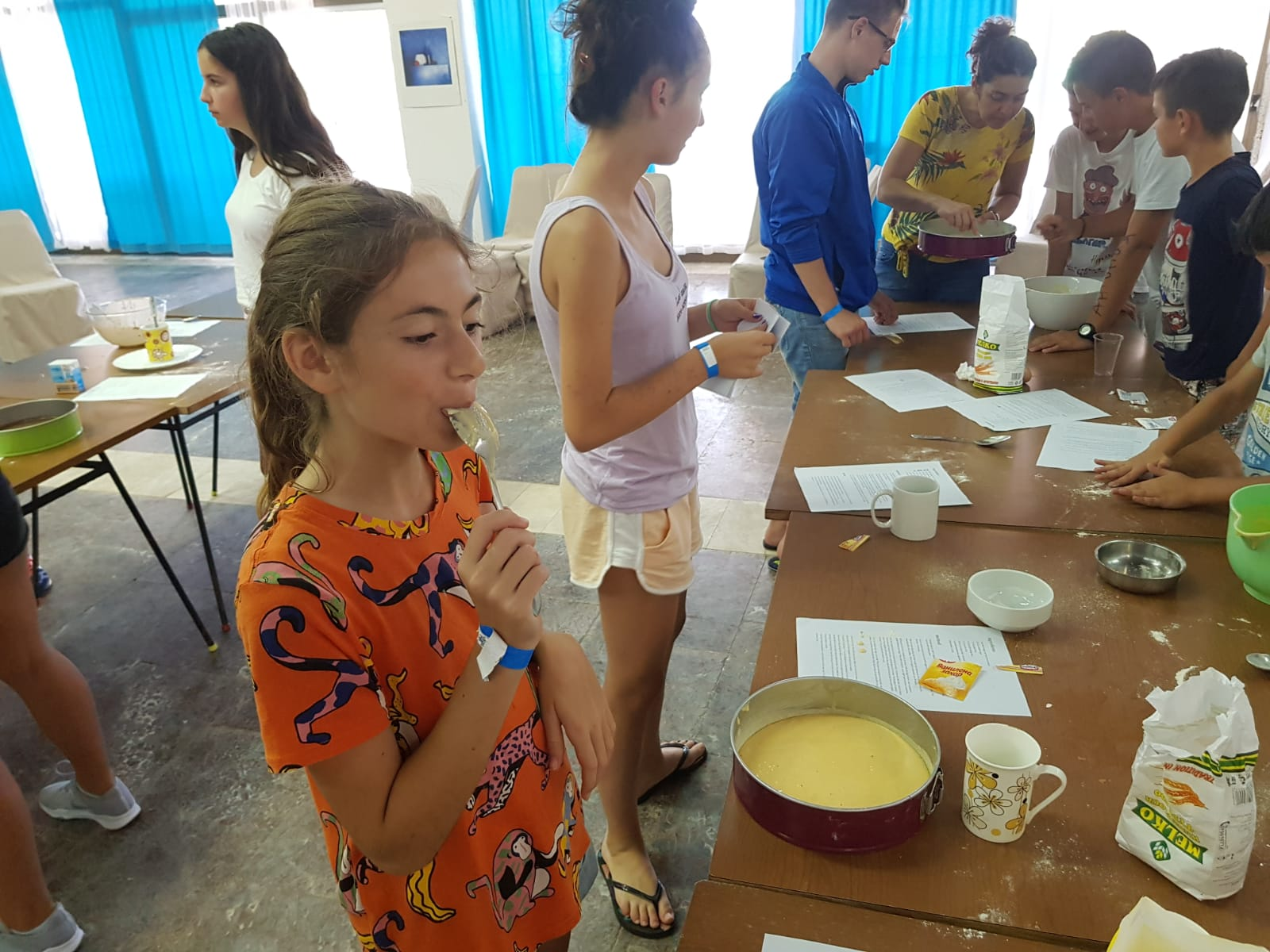 Z camp, day 8 - Making a cake, a table of products and a girl trying the dough