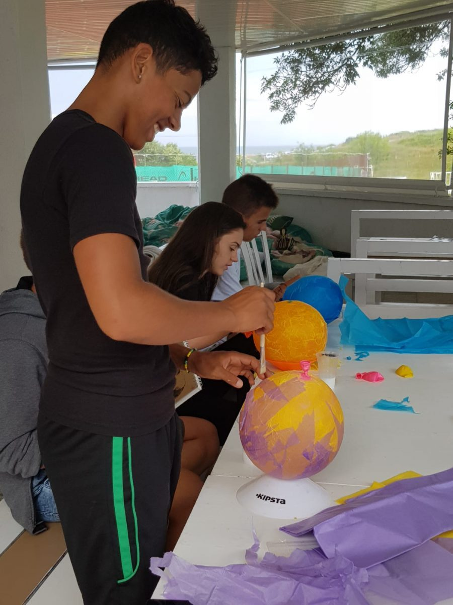 Z camp, day 8 - Arts & crafts, children paint balloons for planets