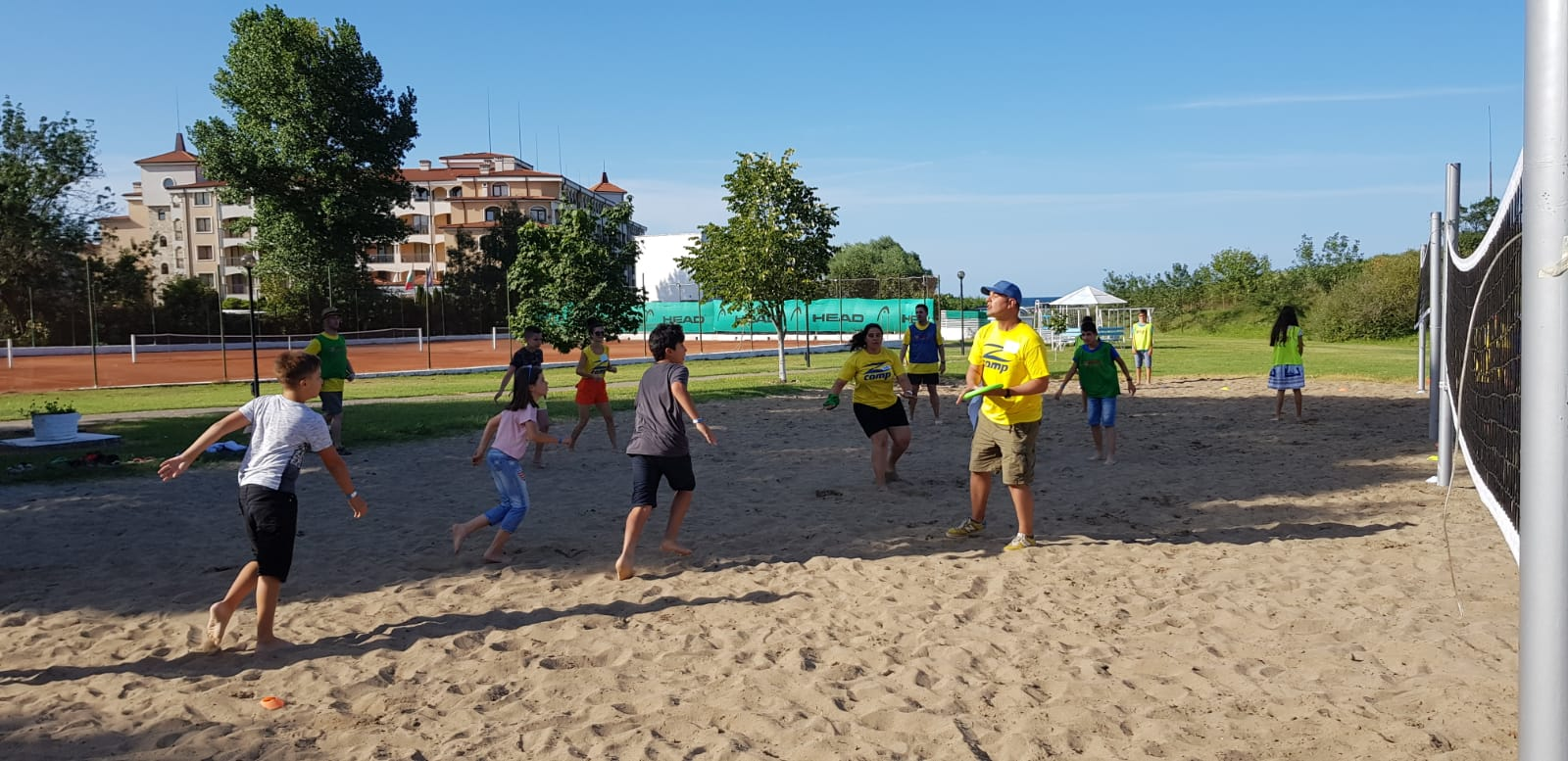 language camp for kids at seaside Z camp, Day 26 - volleyball court - children are playing