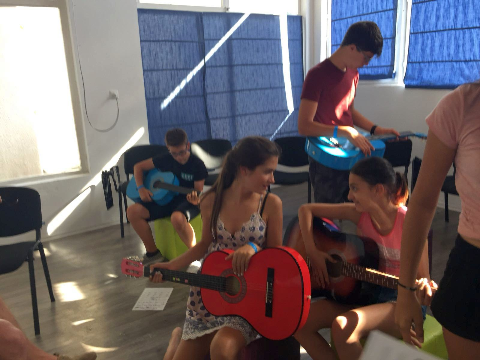 language camps for kids at Bulgarian seaside Z camp, Day 28 - musical workshop - two girls and two boys with acoustic guitars