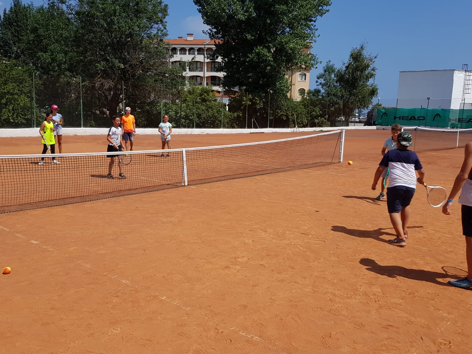 Z camp, day 14 - tennis court, group of children play