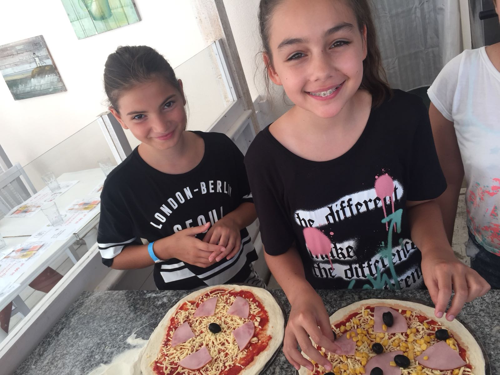 Z camp, day 14 - cooking workshop, making pizza, 2 girls with ready-to-cook pizza