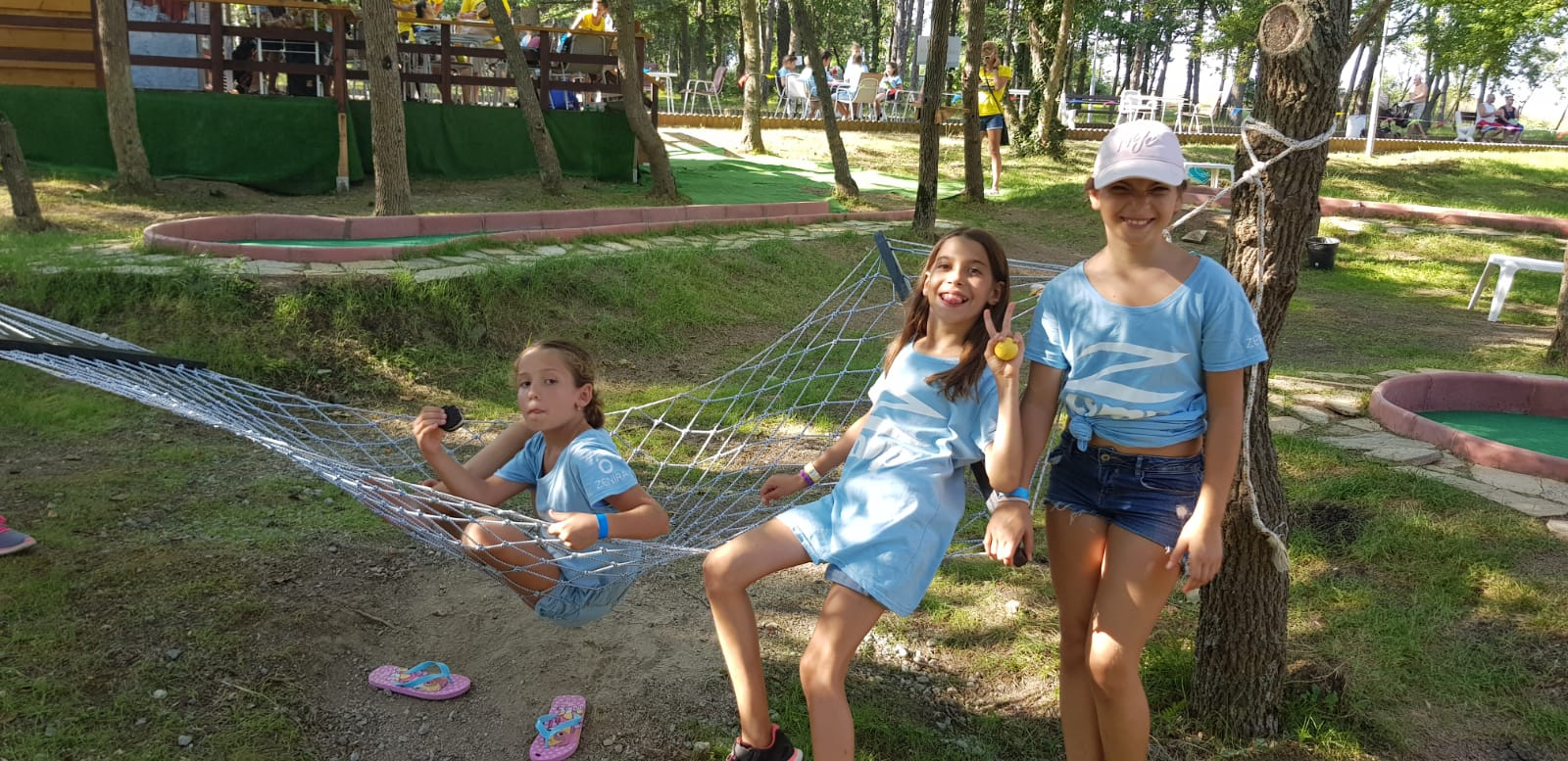 Z camp, day 19 - mini golf in Tsarevo - 3 girls with T-shirt of Z camp are at the hammock