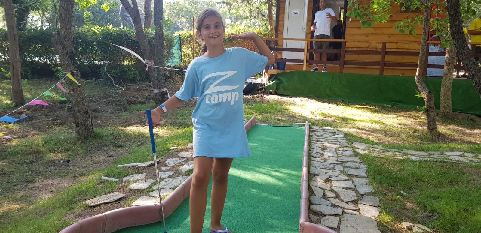 Z camp, day 19 - mini golf in Tsarevo - girl with T-shirt of Z camp