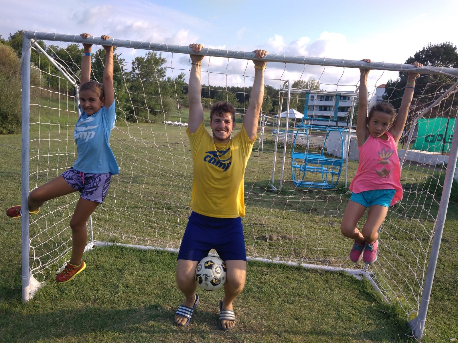 Z camp, Day 17 - Two children and a teacher hang on the football door