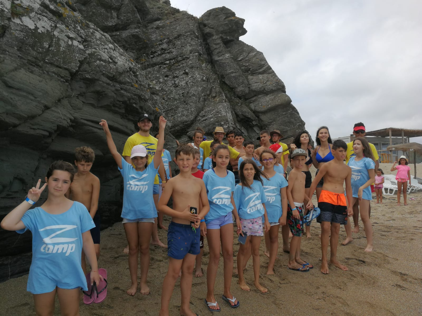 Z camp, Day 17 - Veleka river trip - a photo of everyone on the beach, next to the rocks