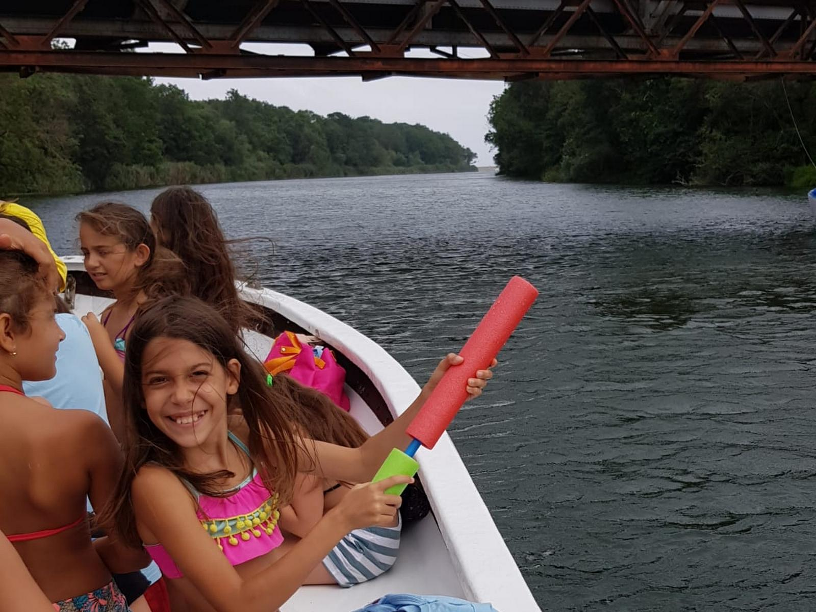 Z camp, Day 17 - Veleka river trip - girl in the boat with a water pistol-tube