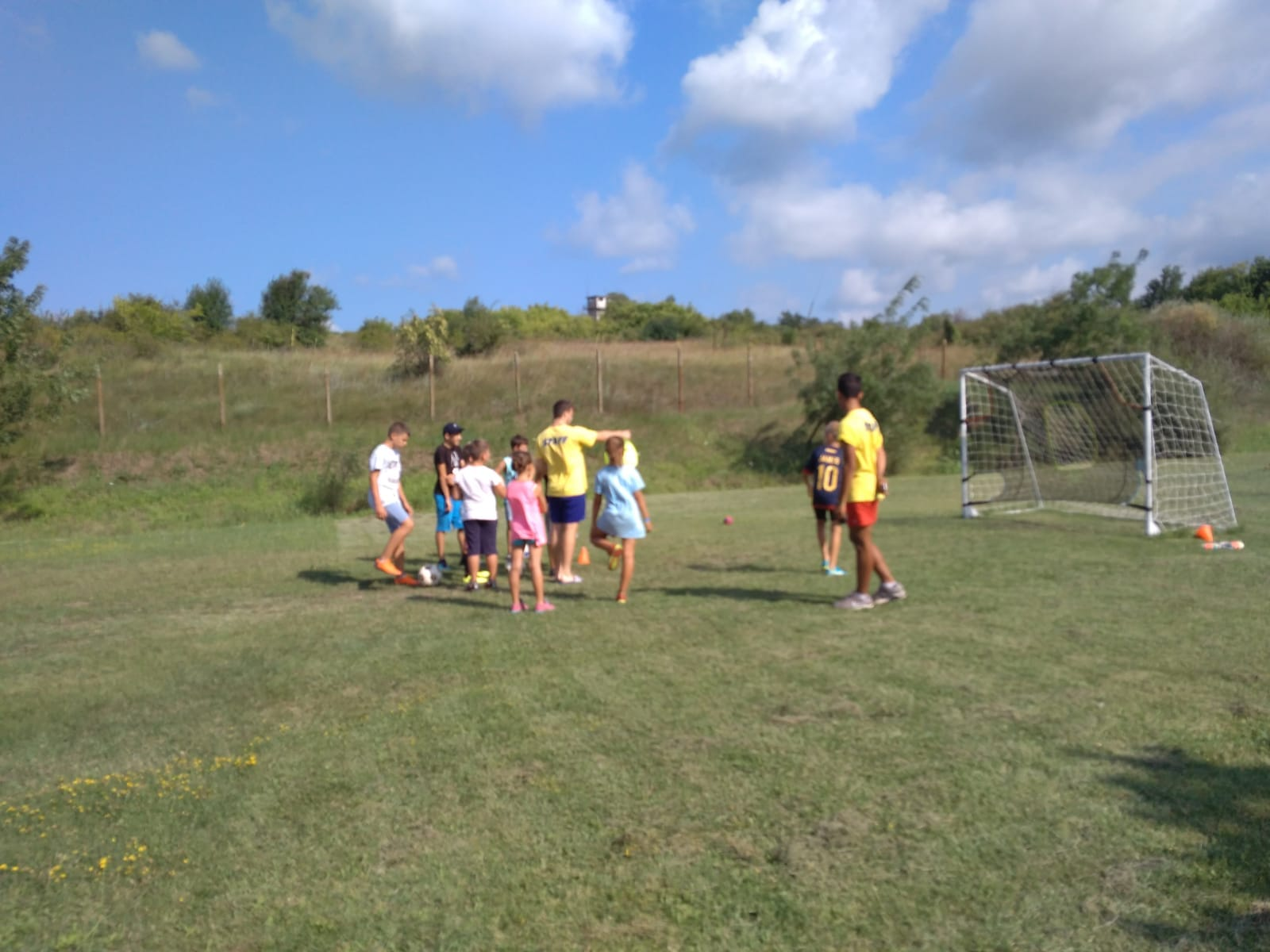 Z camp, Day 17 - a grassy football field - kids are trained on a single door