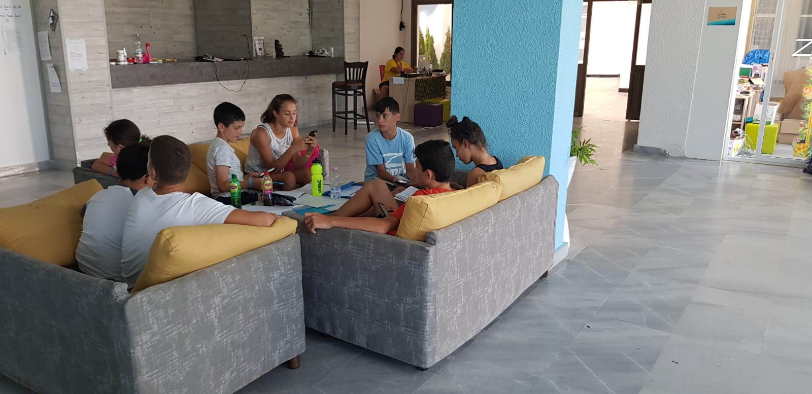 Z camp, Day 20 -in the foyer of the base - 8 children sit on the couch and talk
