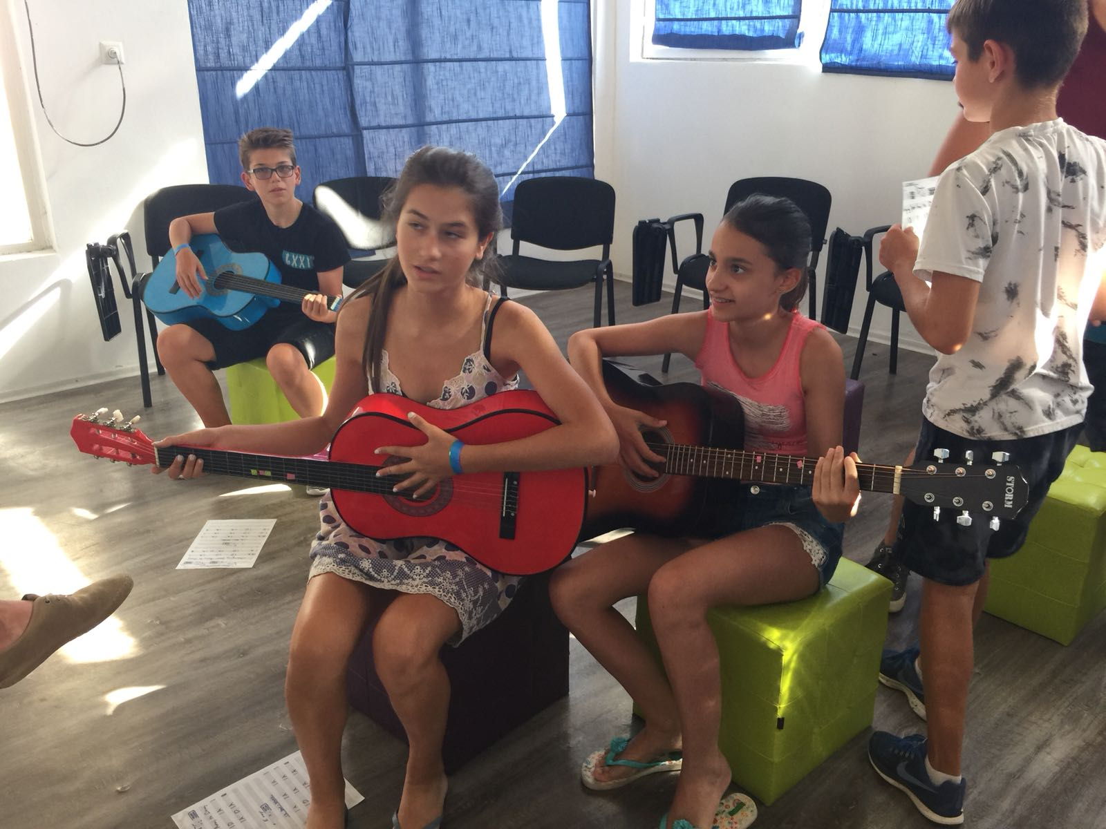 language vacations for kids at Bulgarian seaside Z camp, Day 27 - musical workshop - two girls and one boy with acoustic guitars
