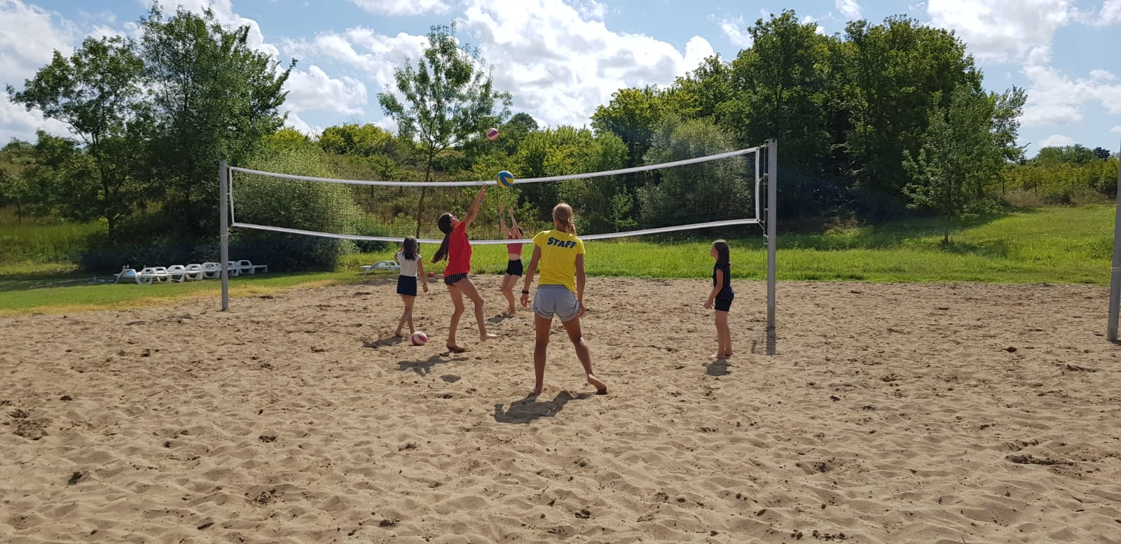 language vacations for kids at Bulgarian seaside Z camp, Day 27 - volleyball court - five girls play