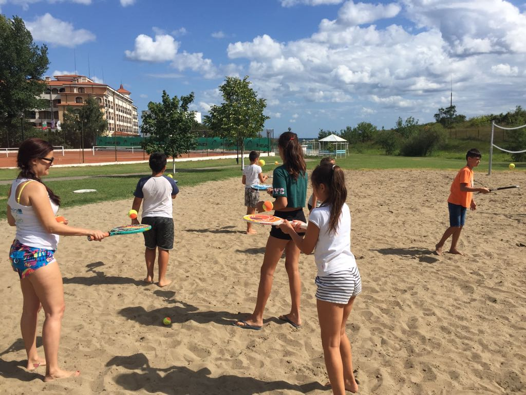 language vacations for kids at Bulgarian seaside Z camp, Day 27 - volleyball court - children with tennis rackets are warming up to play