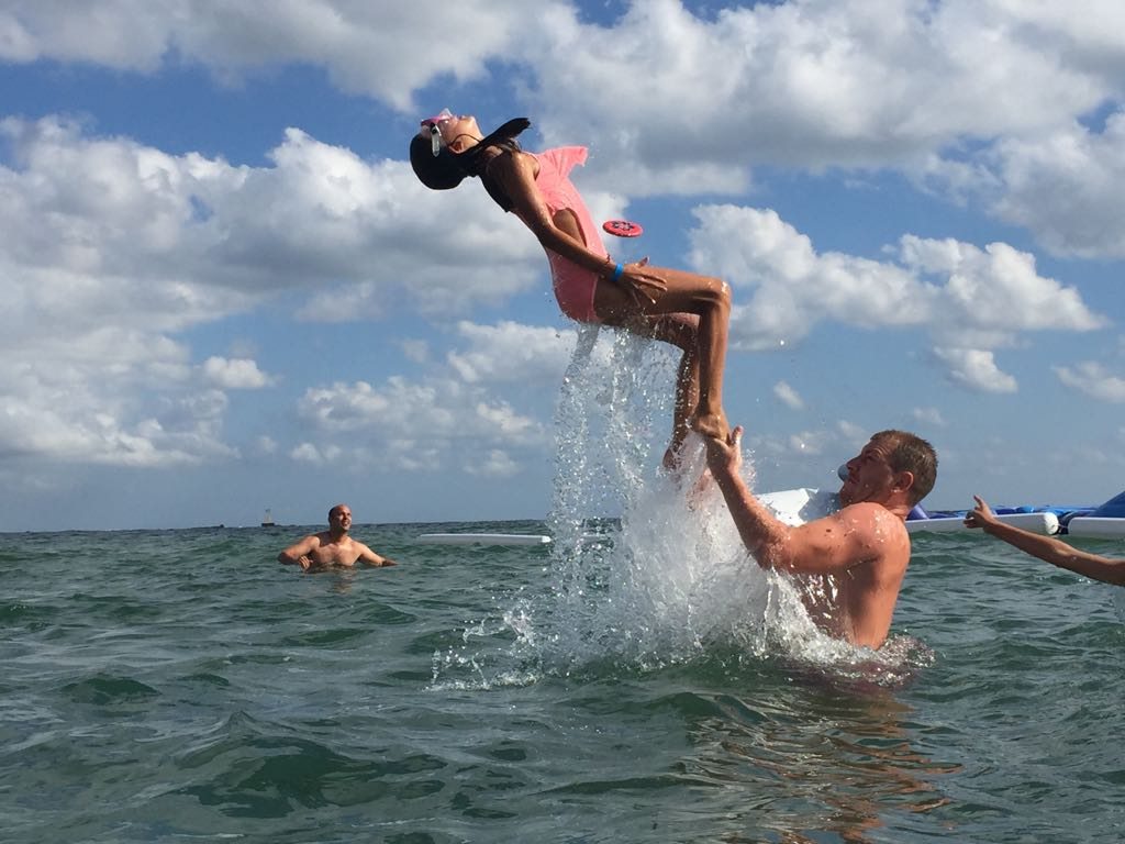 language vacations for kids at Bulgarian seaside Z camp, Day 27 - at the beach - girl makes a salty over the water