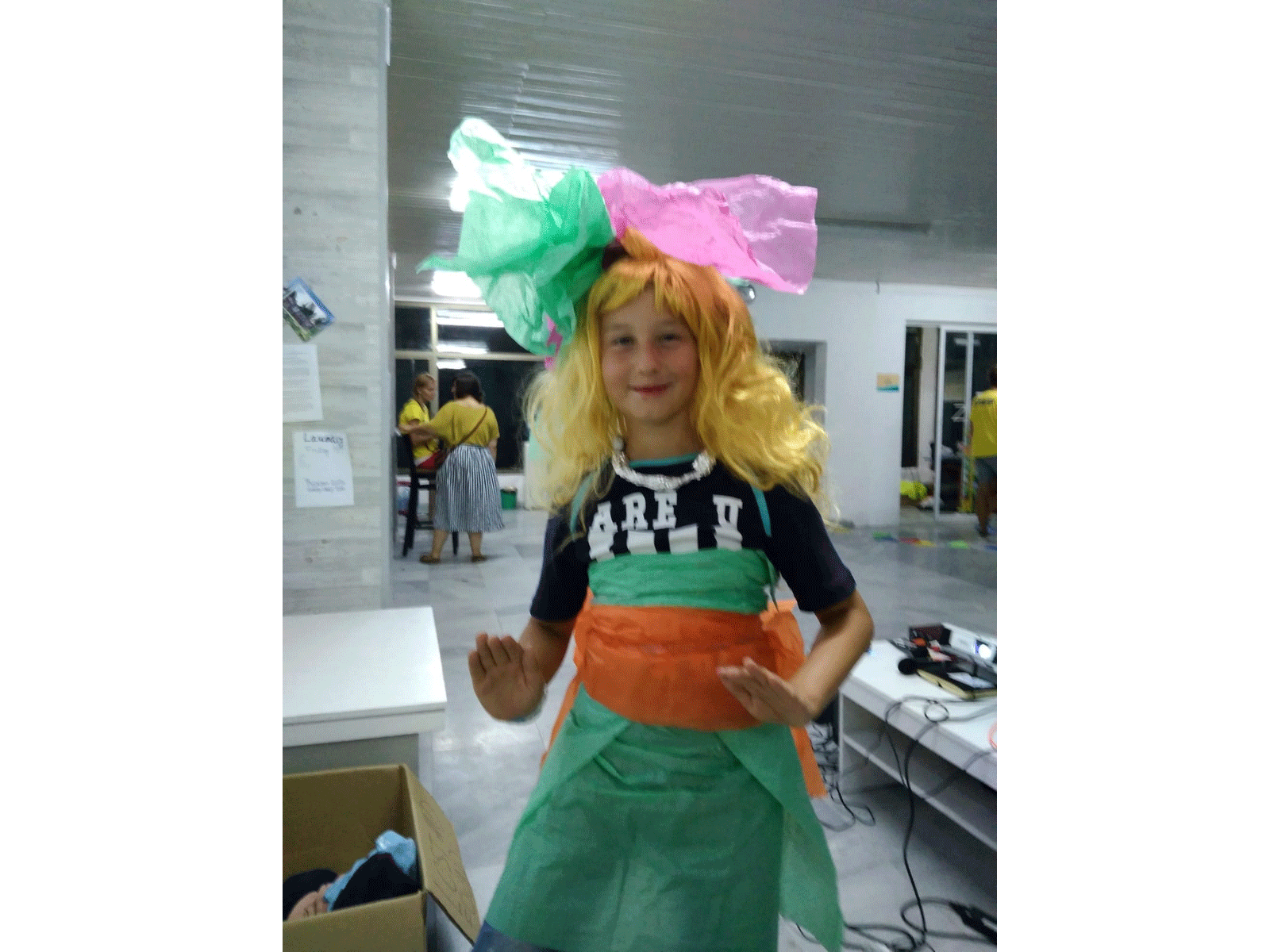 Z camp, Day 18 - fashion show - mermaid girl, blonde wig, green dress and paper ribbons