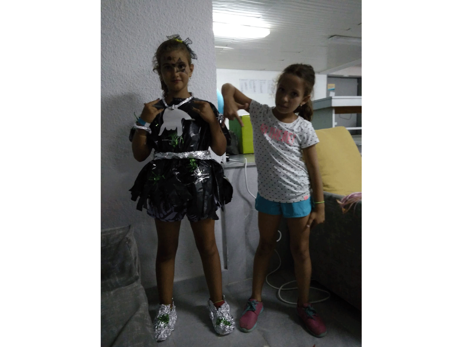 Z camp, Day 18 - fashion show - girl with black dress, nylon sack and metal foil shoes, make-up