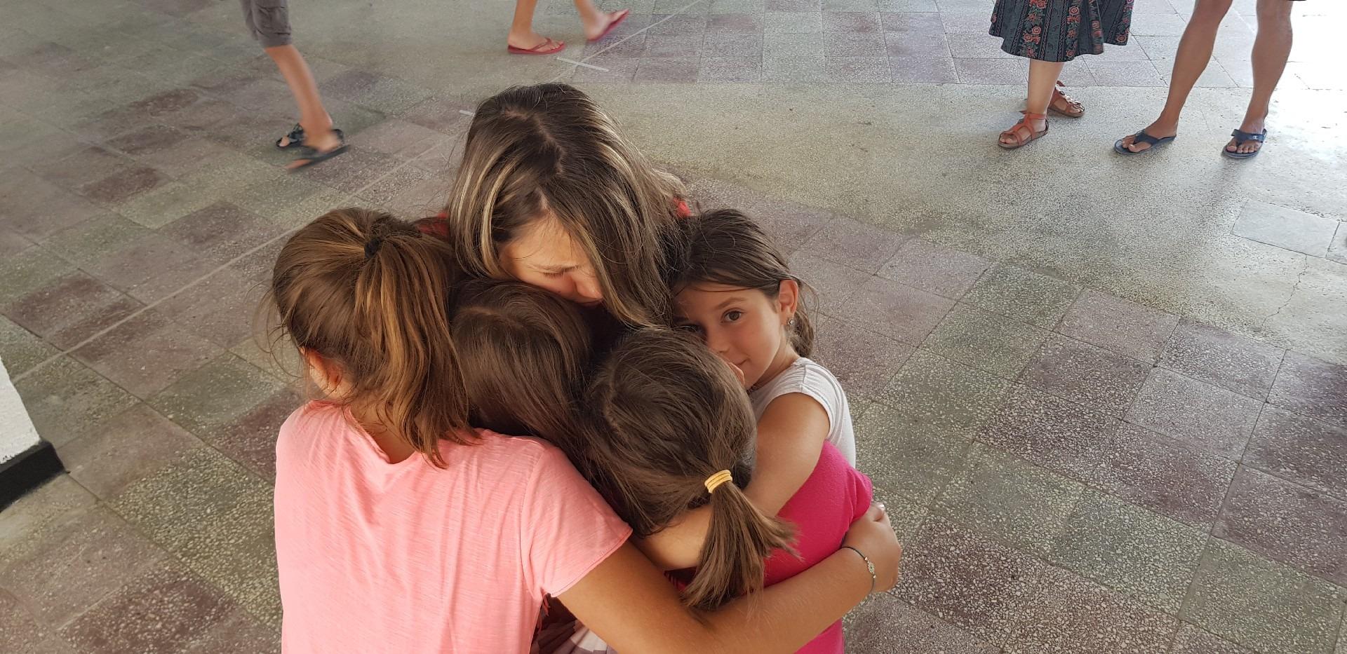 summer language camp in Bulgaria Z camp, Day 35 - group hug of girls
